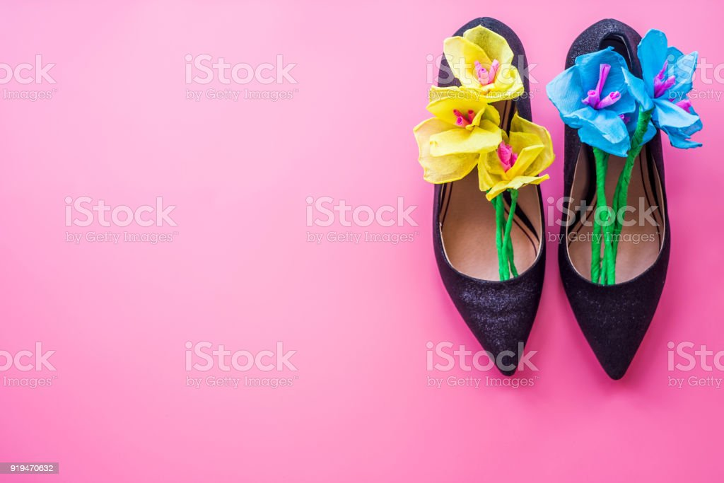 Womans High Heel Shoes With Paper Flowers Inside On Pink Background