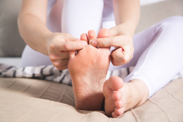 Woman's leg hurts, pain in the foot, massage of female feet Woman's leg hurts, pain in the foot, massage of female feet at home gout stock pictures, royalty-free photos & images