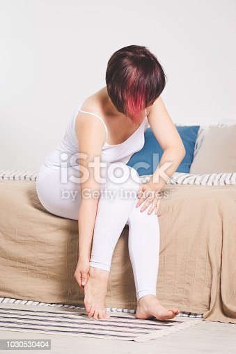 901404510istockphoto Woman's leg hurts, pain in the heel, massage of female feet 1030530404