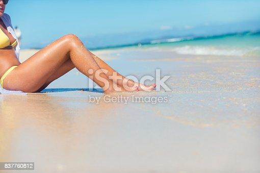 670374358 istock photo Womans legs alone on a beach. 837760812