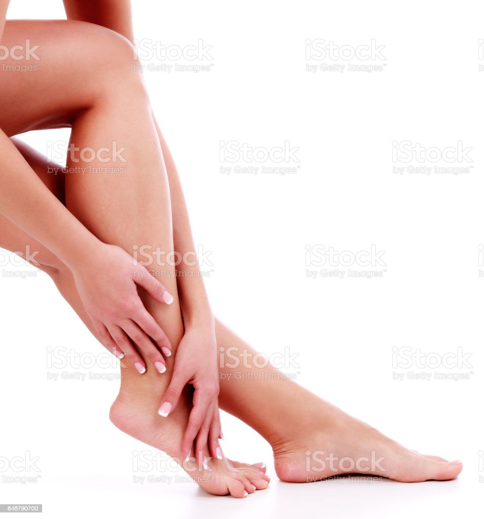 Woman's legs and hands stock photo
