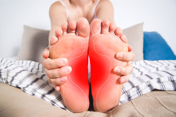 Woman's legs hurts, pain in the foot, massage of female feet stock photo