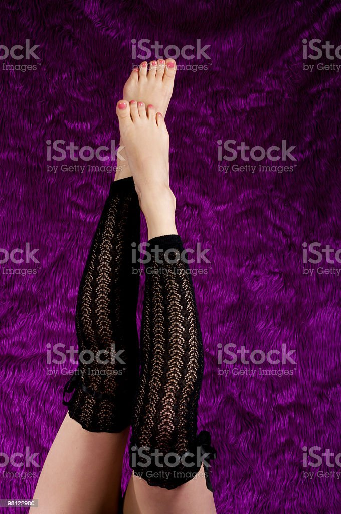 Woman's legs in black fancy hosiery. royalty-free stock photo