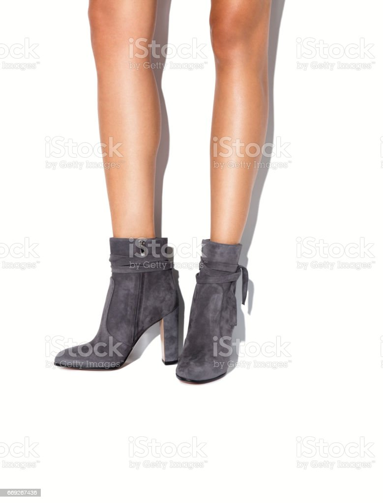 Woman's legs in black high heels on isolated white background stock photo