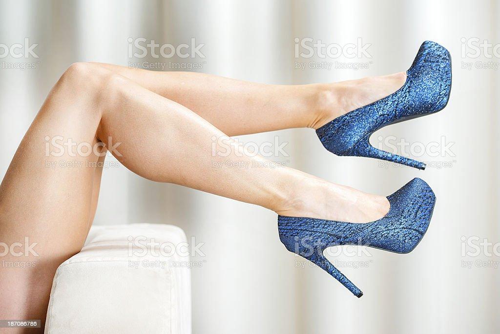 Woman´s legs in glitter blue platform High Heels stock photo