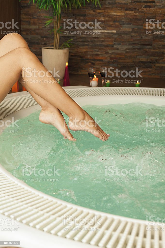 Woman's legs in jacuzzi royalty-free stock photo