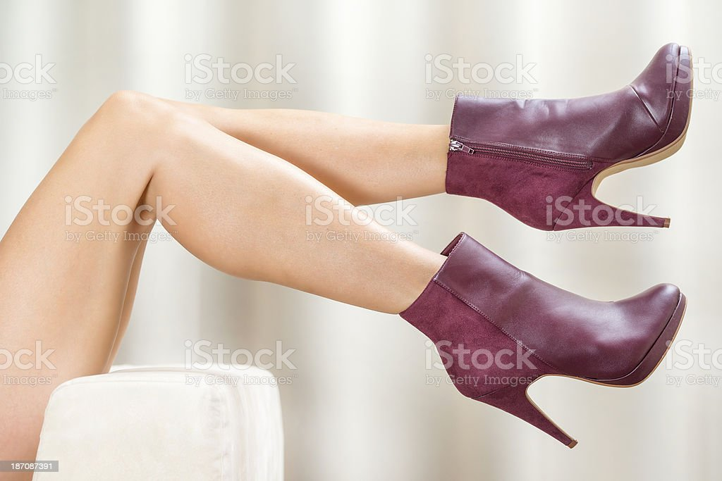 Woman´s legs in red High Heels Ankle Boots stock photo