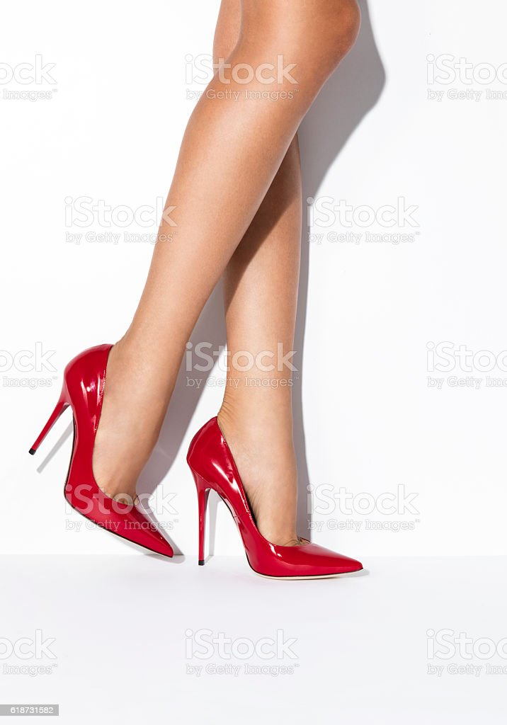 Woman's legs in red high heels stock photo