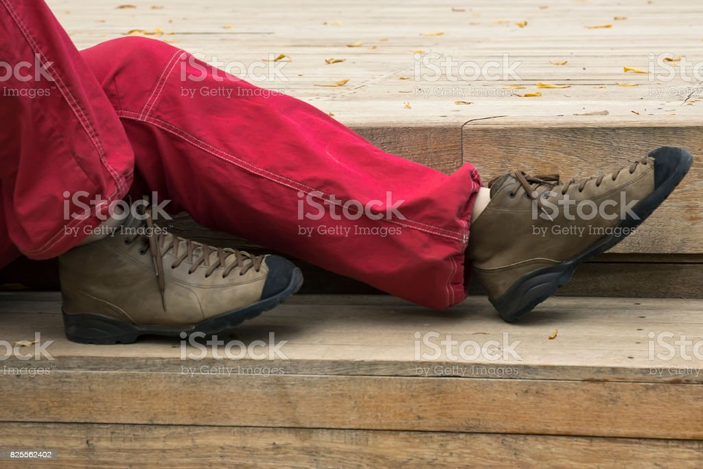 Woman's Legs in Shoes and red Jeans giving Rest stock photo
