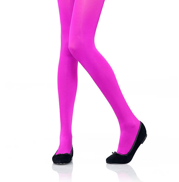 woman's legs modeling bright pink tights - black women wearing pantyhose stock photos and pictures