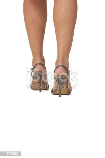 \r\nIsolated woman's legs in higheels sandals.Natural look of the skin.Copyspace for your message in the lower part of the image.