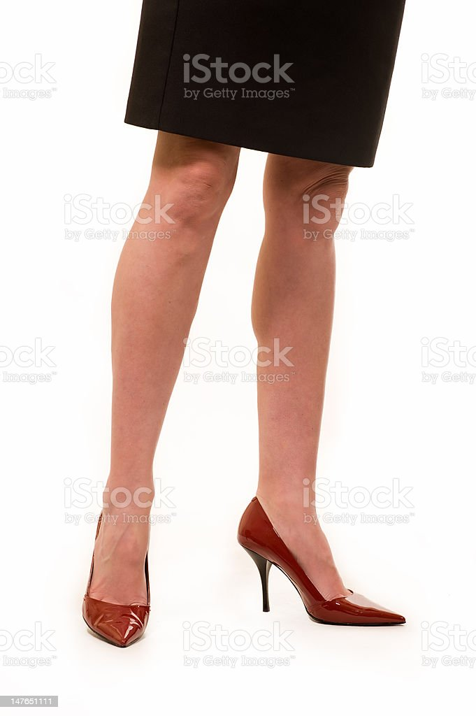 Woman's legs wearing red shoes royalty-free stock photo
