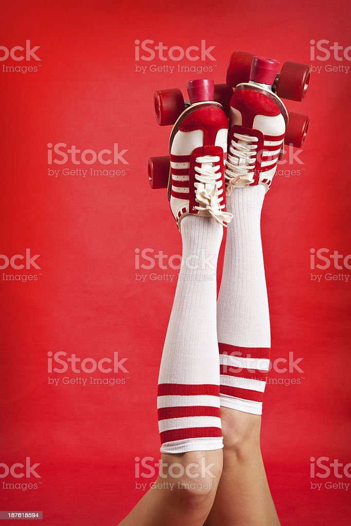 Woman's Legs Wearing Tube Socks And Roller Skates stock photo