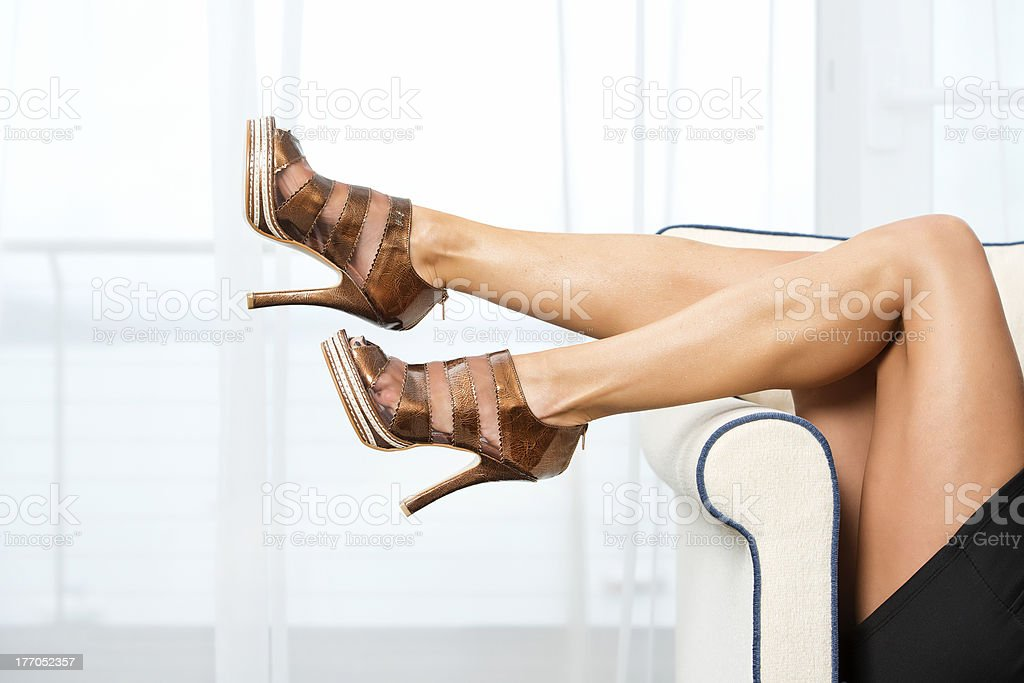 Woman´s legs with High Heels ankle boots stock photo