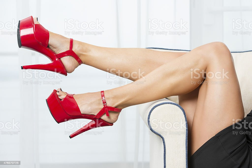 Woman´s legs with red platform High Heels stock photo