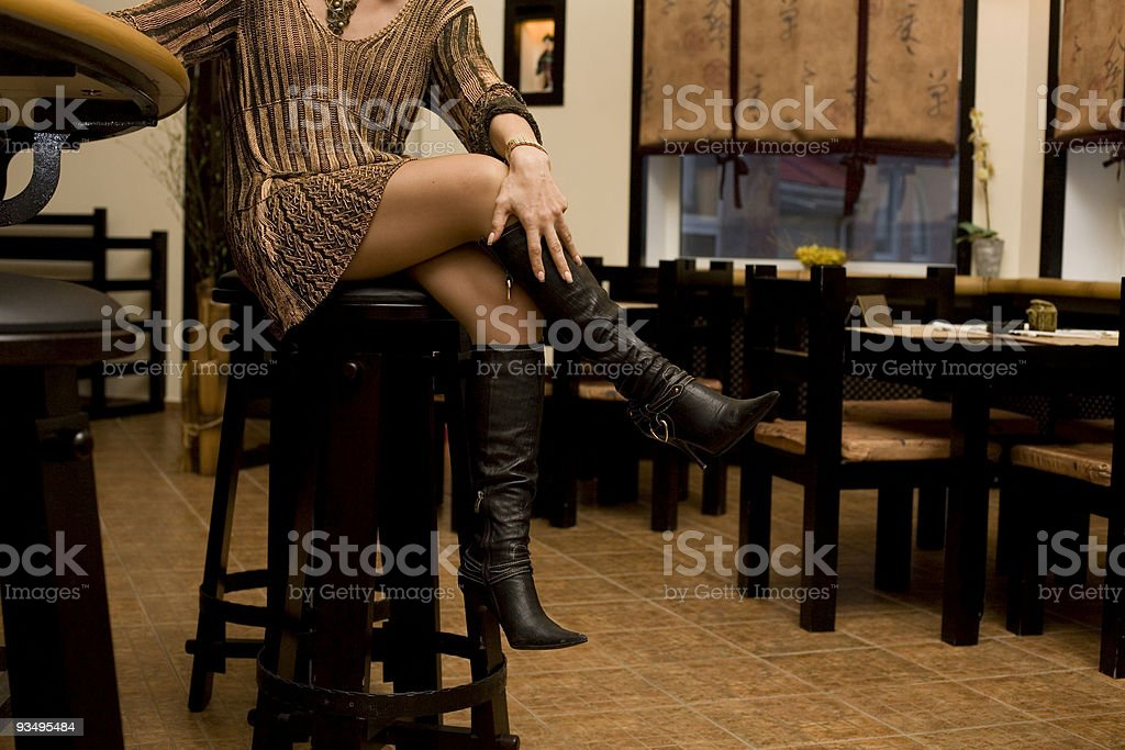 Woman's legs. Woman sitting in japanese bar royalty-free stock photo