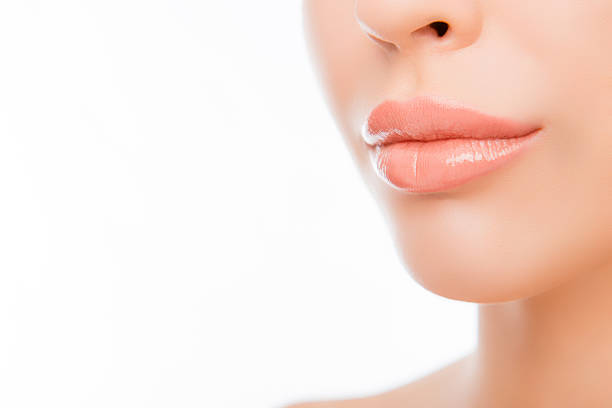 woman's lips with natural make up on white background - injection de toxine botulique photos et images de collection