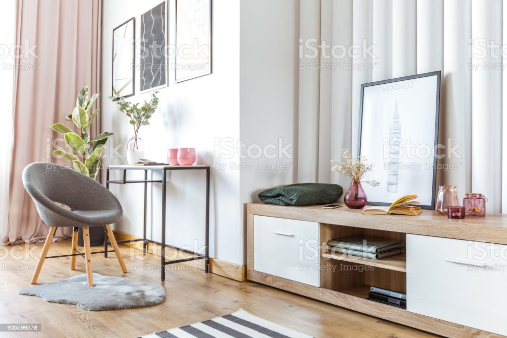 Woman's living room with poster stock photo