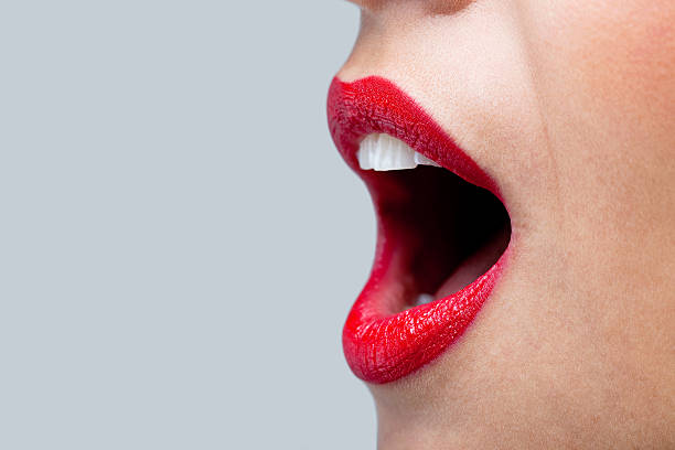 Womans mouth wide open with red lipstick. stock photo