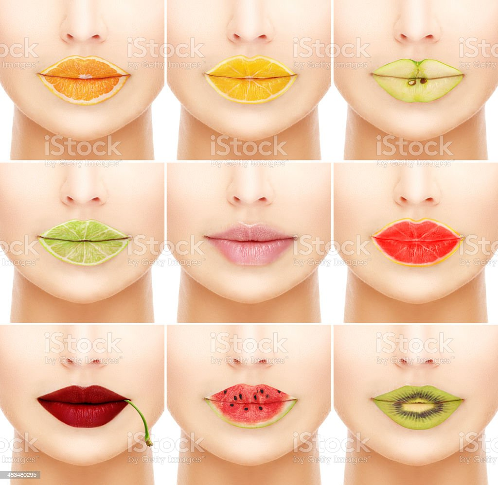 Woman's mouths with fruity lip gloss. stock photo