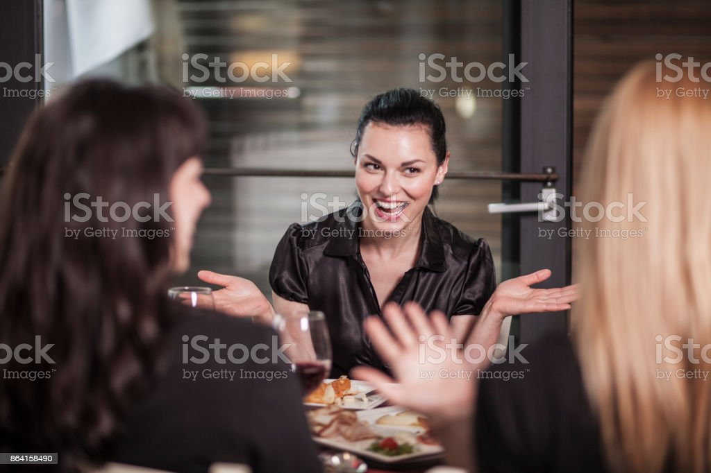 Woman's night out in restaurant royalty-free stock photo