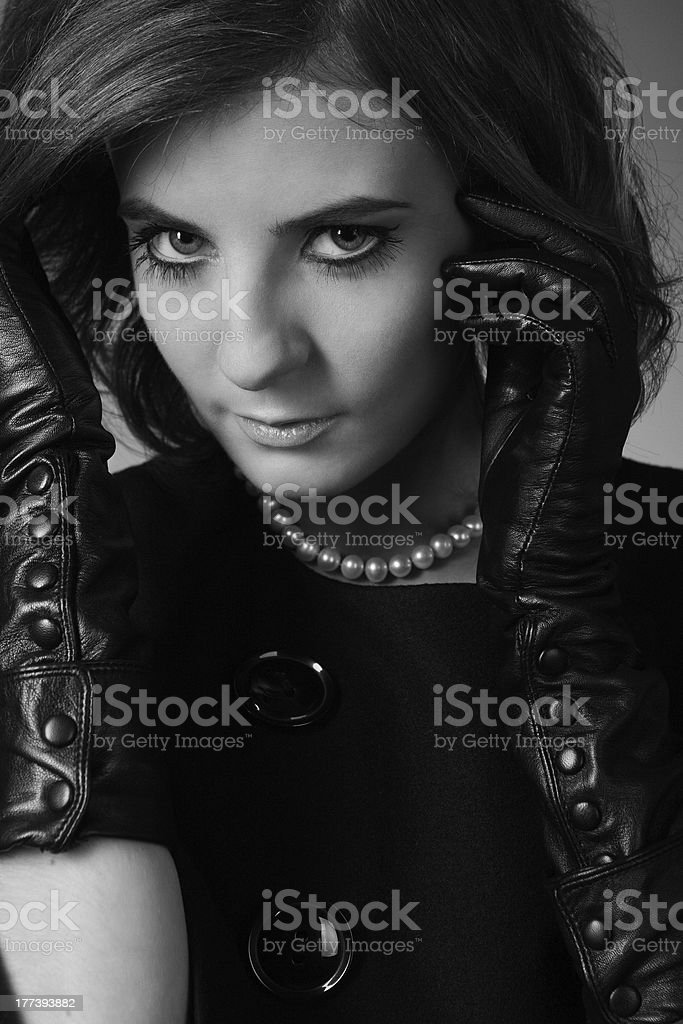 woman's portrait in black leather gloves royalty-free stock photo