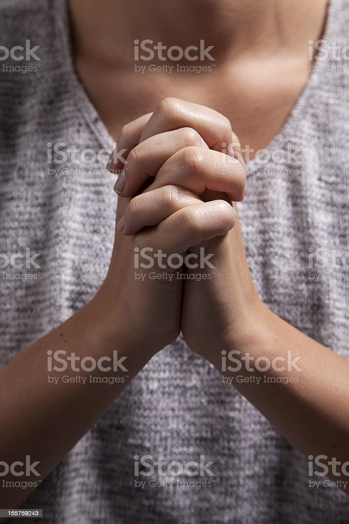 Woman's Praying Hands royalty-free stock photo