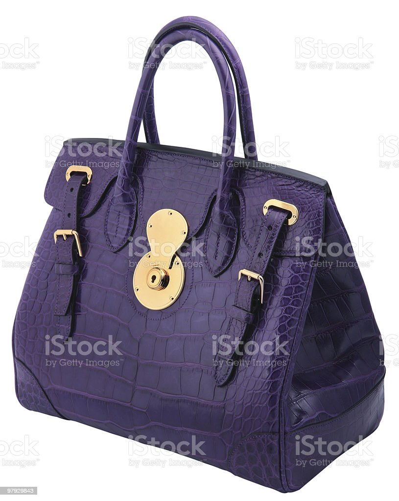 A woman's purple leather handbag royalty-free stock photo