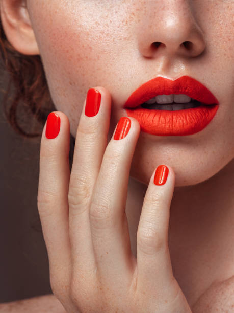 Woman's red lips and manicure close-up stock photo