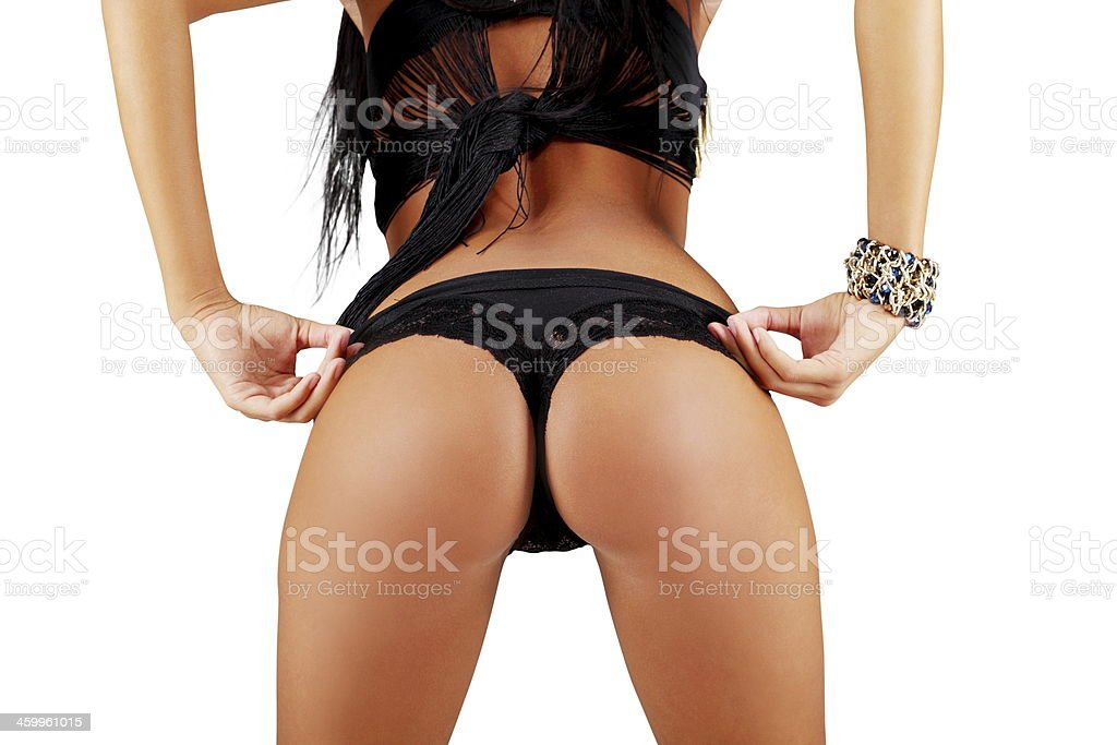Woman's sexy buttocks in a bikini stock photo