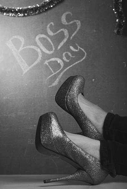 woman's Shoe with rhinestones closeup, A woman's Shoe with rhinestones closeup, of the inscription chalk on the background, boss's day, concept business woman boss's day stock pictures, royalty-free photos & images