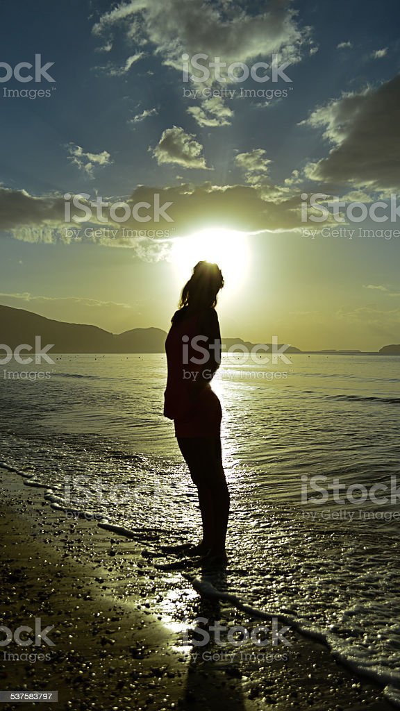 Womans silhouette posing at the beach & greece stock photo