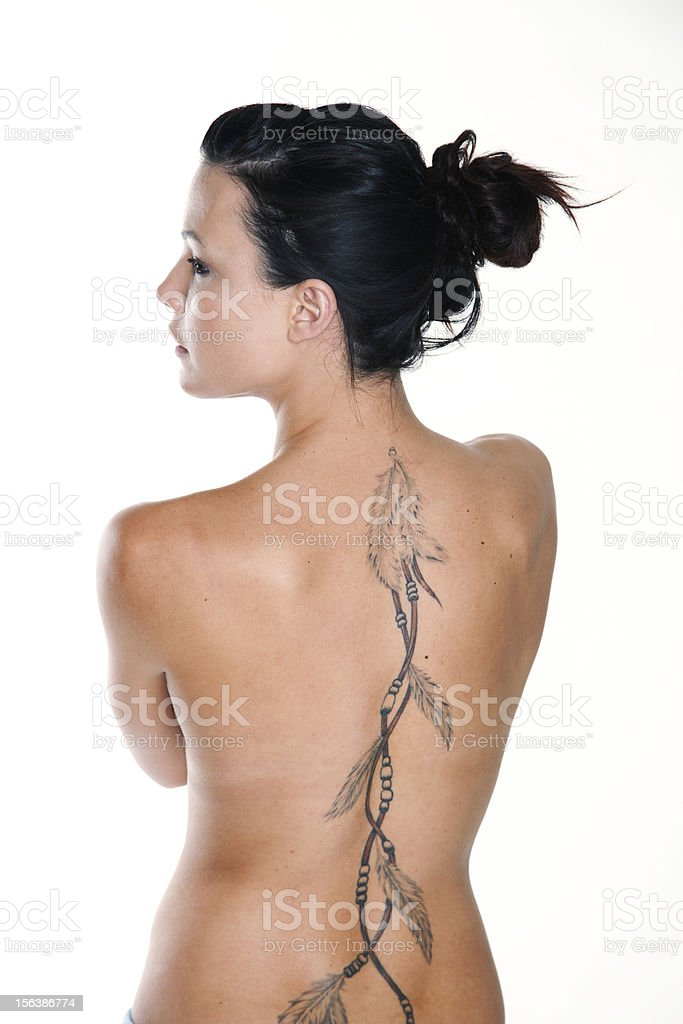Woman's torso with large tattoo royalty-free stock photo