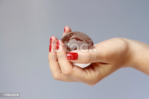 woman holding glass globe, concept world in woman's hand