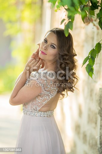 1054970060 istock photo Women 28-35 years old in a public park in a romantic old-style dress 1207091353