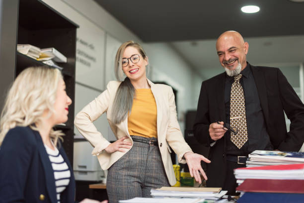 women and boss talking relaxing in office having a break women and boss talking relaxing in office having a break while working with documentation age contrast stock pictures, royalty-free photos & images