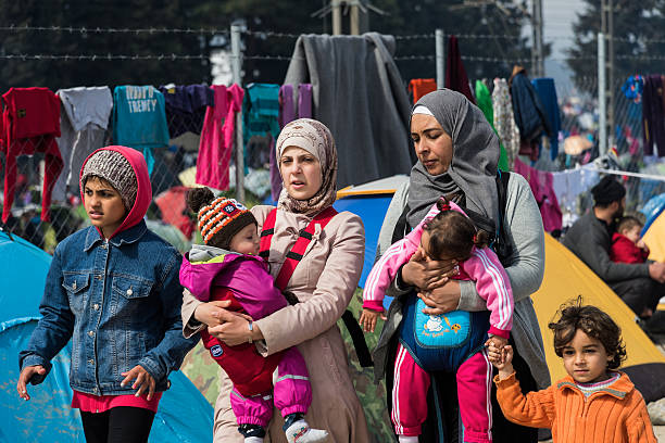 Women and children in refugee camp in Greece stock photo