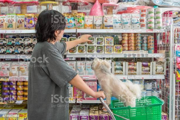 Women and her dog shop a pet food on pet goods shelf in pet shop picture id674942584?b=1&k=6&m=674942584&s=612x612&h=a4xwu2otfwjco9sdeeq sivwnu 7bjh9s49yewefszm=