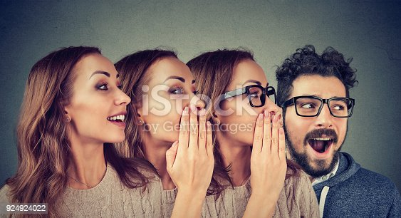 istock Women and man sharing with gossip 924924022