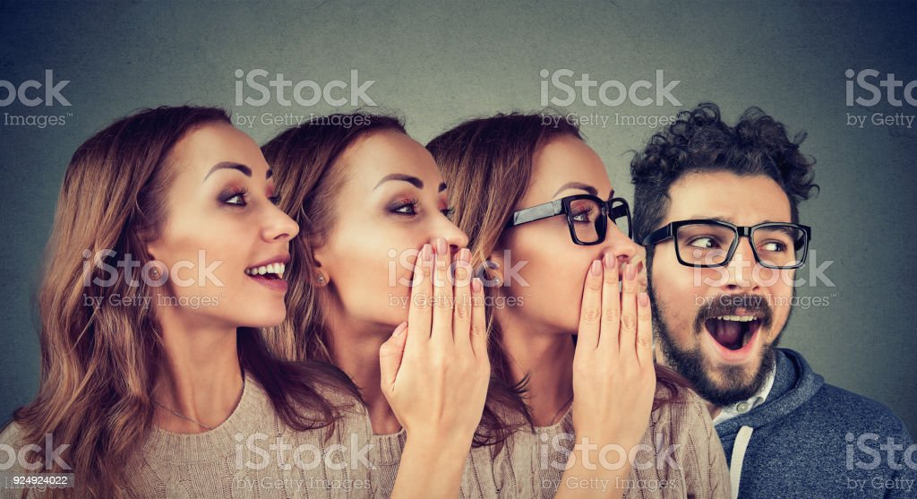 Women and man sharing with gossip stock photo