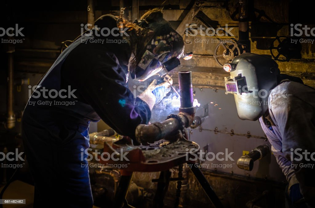 Women and Man welding. royalty-free stock photo