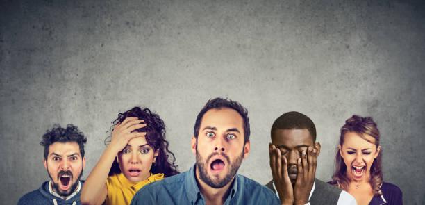 Women and men expressing anger, desperation, shock stock photo