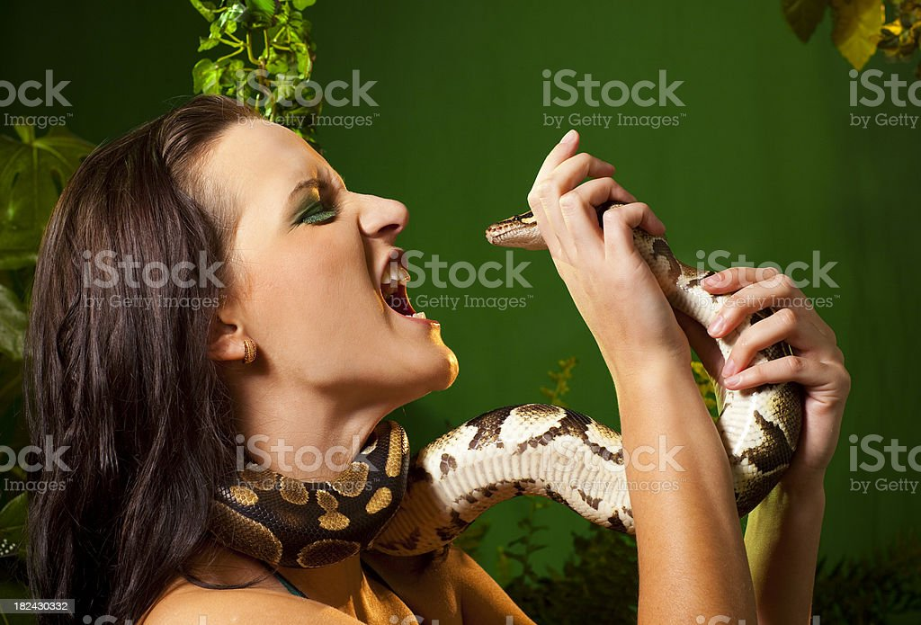Women and snake fight stock photo