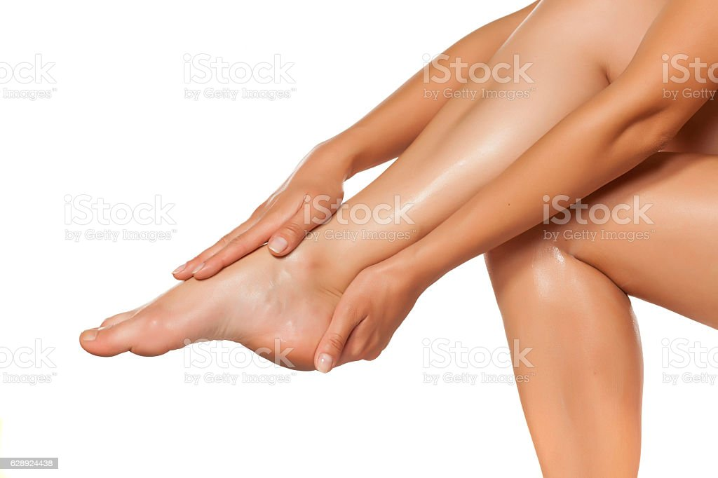 women applied the cream on her beautiful legs stock photo