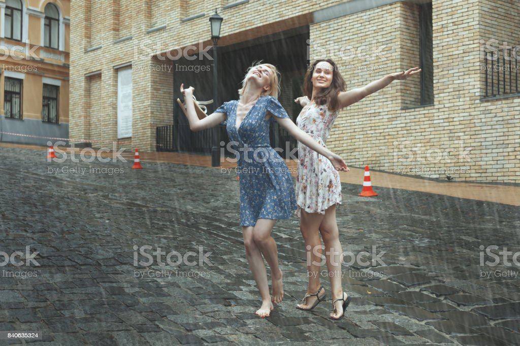 Women are happy with the rain. stock photo