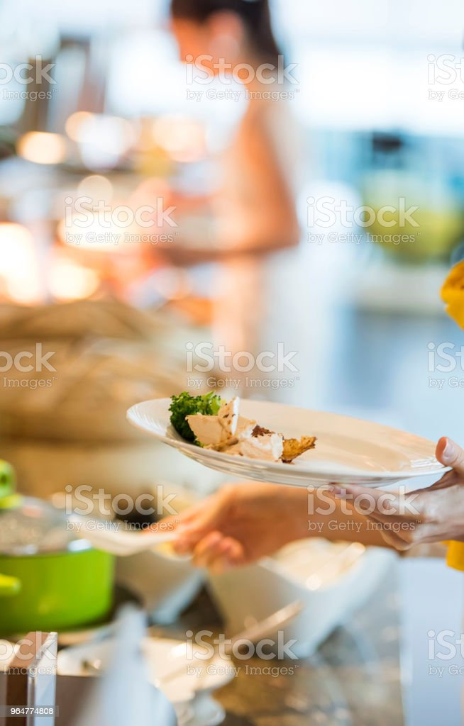 Women are having hotel buffet food royalty-free stock photo