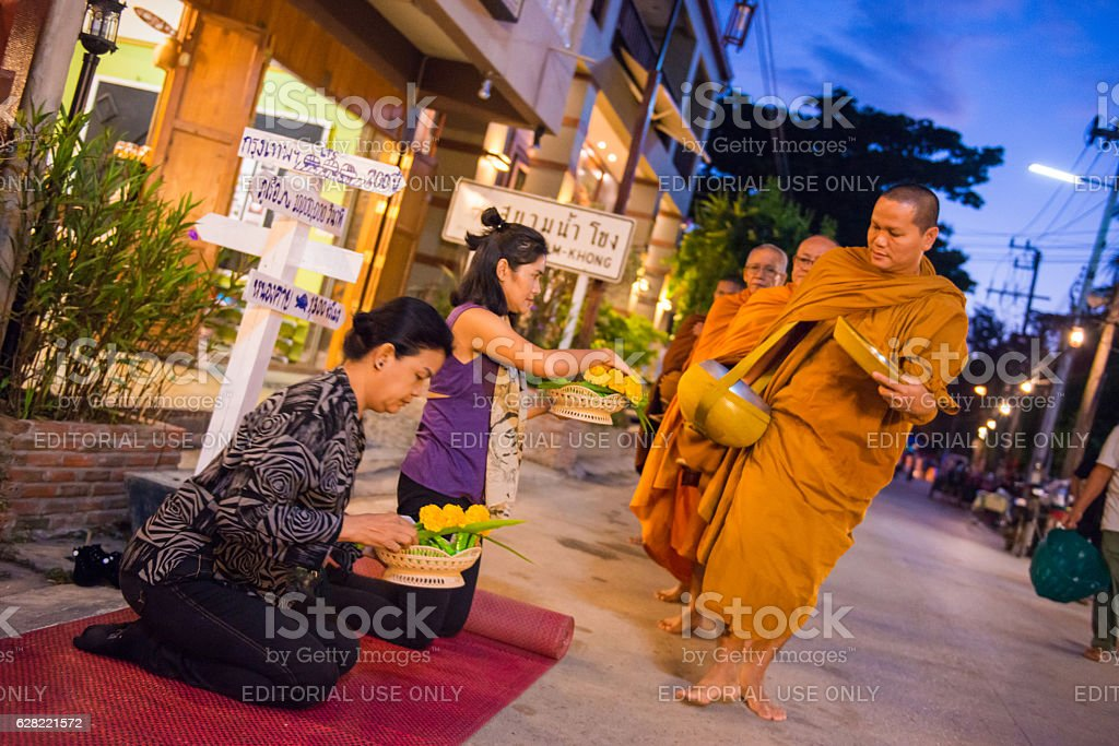 women are preparing food for giving alms to buddhist monks stock photo