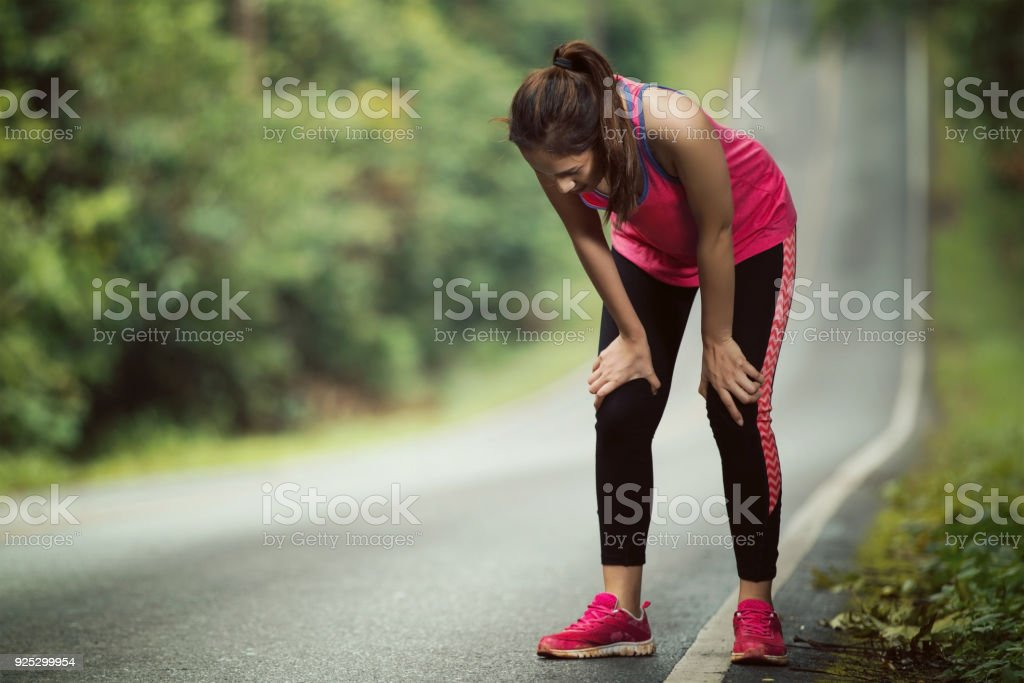 Women are tired From jogging on a steep slope stock photo