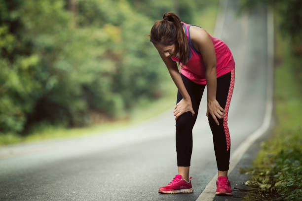 women are tired from jogging on a steep slope - exhaustion stock pictures, royalty-free photos & images