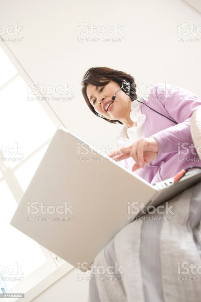 Women are using the Internet royalty-free stock photo